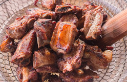 Fried pork ribs. On wire mesh Stock Photography