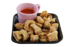 Fried pork rinds with sauce an isolate Stock Image
