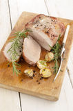 Fried pork roast on a wooden board Stock Image