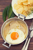 Fried pork with sauce and fried egg in dish Royalty Free Stock Images