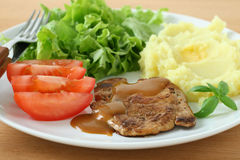 Fried pork with sauce and mashed potato Stock Photo