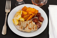 Fried pork with sausages, pumpkin Stock Images