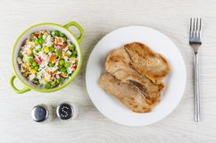 Fried pork schnitzel in plate, bowl with vegetable mix, condimen Stock Image
