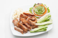 Fried pork served with various vegetables Royalty Free Stock Images