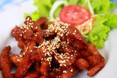 Fried pork with sesame. Closeup of fresh fried pork with sesame, thai food Royalty Free Stock Images