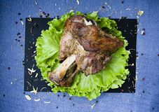 Fried pork shank with salad royalty free stock photography