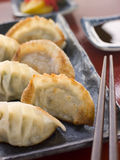 Fried Pork and Shrimp Dumplings with Soy Sauce Royalty Free Stock Photography