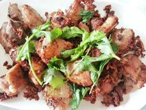 Fried pork spare ribs with garlic and pepper. Thai dish: Fried pork spare ribs with garlic and pepper Royalty Free Stock Images