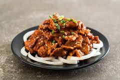 Fried pork with spicy korean sauce (bulgogi). Korean food style stock photos