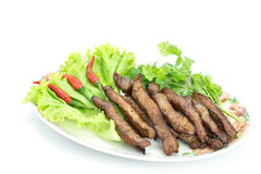 Fried pork, Thai food served with vegetable. Isolated on white background Stock Image