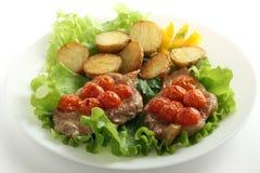 Fried pork with tomato and potato Stock Photo