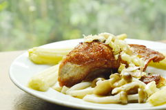 Fried pork topping garlic with boiled baby corn and Buna shimeji mushroom on plate Stock Images