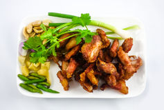Fried pork. With a vegetable side dish - soft focus Royalty Free Stock Photos