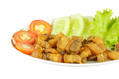 Fried pork and vegetables. Fried pork  with tomato, cucumber and lettuce on white background Stock Photos