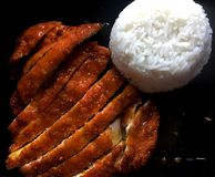 Fried Porkchop med ris Arkivfoton