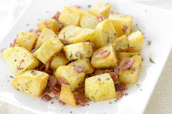 Fried potato with bacon Stock Photo