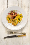 Fried potato, bacon and scrambled eggs Stock Image