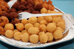 Fried potato balls and meat balls. A plate with fresh fried potato balls and meat balls stock photos