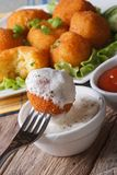 Fried potato balls with sour cream close-up vertical. Royalty Free Stock Photos