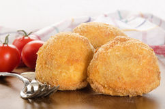 Fried potato balls and tomato Royalty Free Stock Images