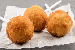 Fried potato balls on white kitchen paper Stock Images