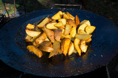 Fried potato in big melal pot. Royalty Free Stock Images