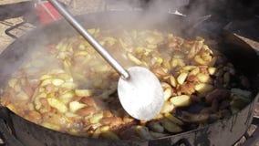 Fried potato in a cauldron stock footage