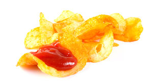 Fried potato chips. And tomato ketchup on a white background Stock Image