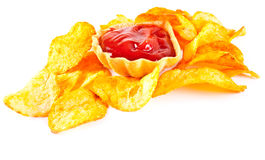 Fried potato chips and tomato ketchup Royalty Free Stock Photos