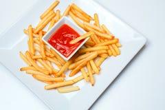 Fried Potato com o tomate no fundo branco Fotografia de Stock