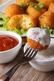 Fried potato croquettes with sour cream close-up vertical. Stock Images