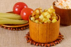 Fried potato cubes  with sour cabbage Stock Images