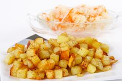 Fried potato cubes  with sour cabbage Royalty Free Stock Photos