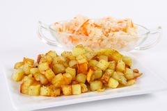 Fried potato cubes  with sour cabbage Stock Photos