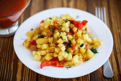 Fried potato cubes with sweet pepper Stock Photo