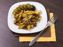 Fried potato with cucumber Royalty Free Stock Image