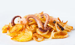 Fried potato with cuttlefish octopus, mussels, shrimp. White background. Royalty Free Stock Images