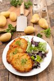 Fried potato galette. On wood Royalty Free Stock Images
