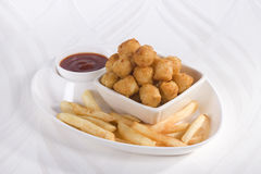 Fried Potato Nuggets with French Fries Royalty Free Stock Photos