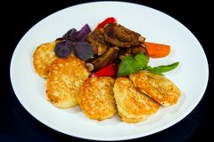 Fried potato pancakes, barbecued pork ribs, served with basil, grilled carrots and paprika. Restaurant menu photo stock images