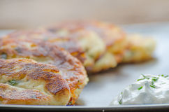 Fried potato pancakes with chive dip/souce Royalty Free Stock Photo