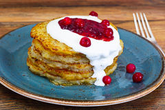 Fried Potato Pancakes with Cranberry Jam. Belarusian and German stock photo
