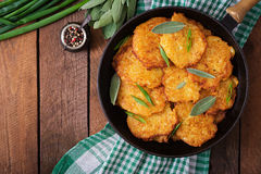 Fried potato pancakes in a frying pan Stock Images