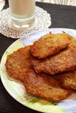 Fried potato pancakes and milk Stock Images