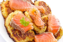Fried potato pancakes with salted salmon Royalty Free Stock Image