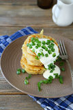 Fried potato pancakes with sour cream Stock Photography