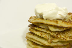 Fried potato pancakes with sour cream sauce Royalty Free Stock Photos