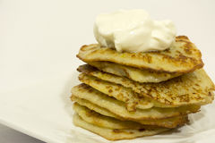 Fried potato pancakes with sour cream, sauce, cooked vegetables, Stock Photography