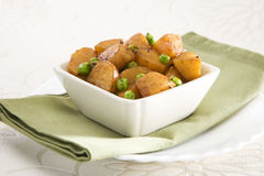 Fried Potato with Peas Stock Photo