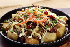 Fried potato with pepper Royalty Free Stock Photos
